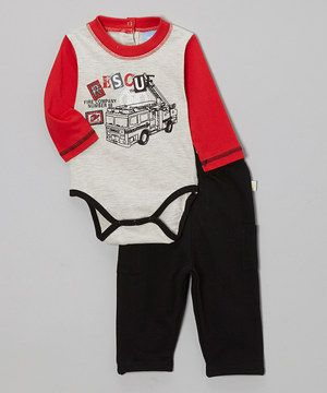 This whimsical set features a long-sleeve bodysuit with quick snap bottoms and a cool graphic. It combines with comfy elastic waistband pants for a look that's both comfortable and adorable.
