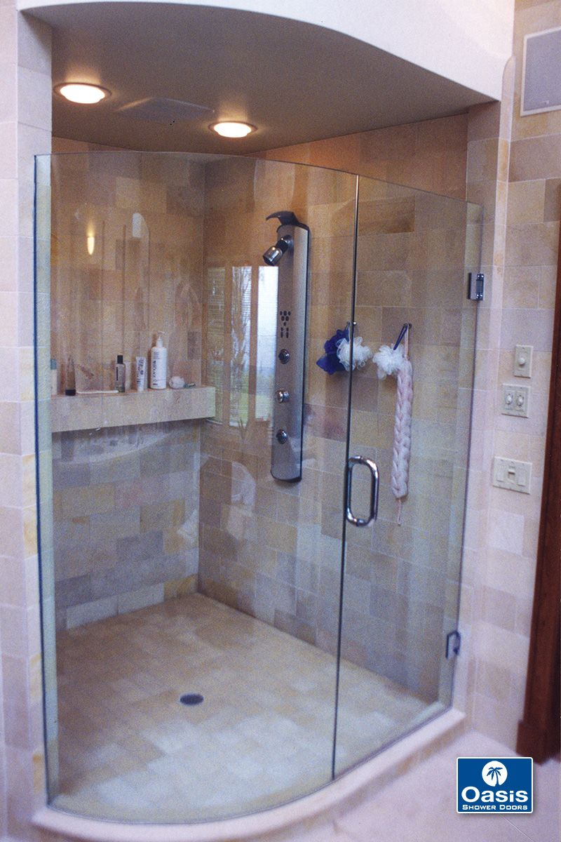 Frameless Shower Door Features Curved Fixed Panel And Wall Mount
