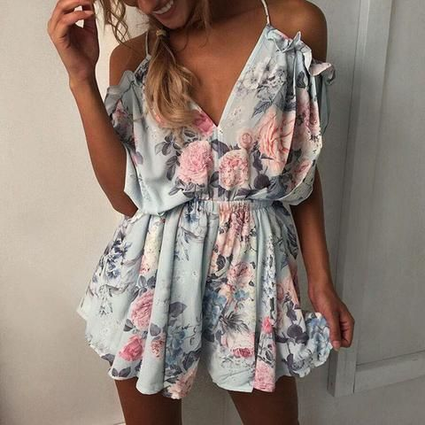 3cc753a45b4 The Light Blue Floral Romper. This sweet flowy romper is the perfect go-to  for the hot days. Featuring off the shoulder sleeves with a tie open back  and ...