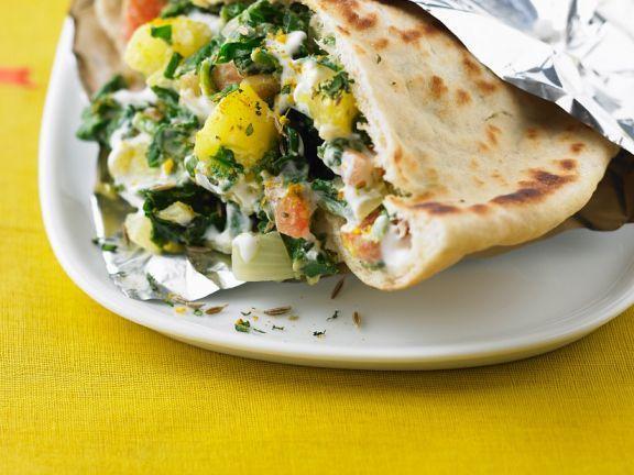 Fladenbrot mit Spinat, Kartoffelwürfeln und Joghurt ist ein Rezept mit frischen Zutaten aus der Kategorie Blattgemüse. Probieren Sie dieses und weitere Rezepte von EAT SMARTER!