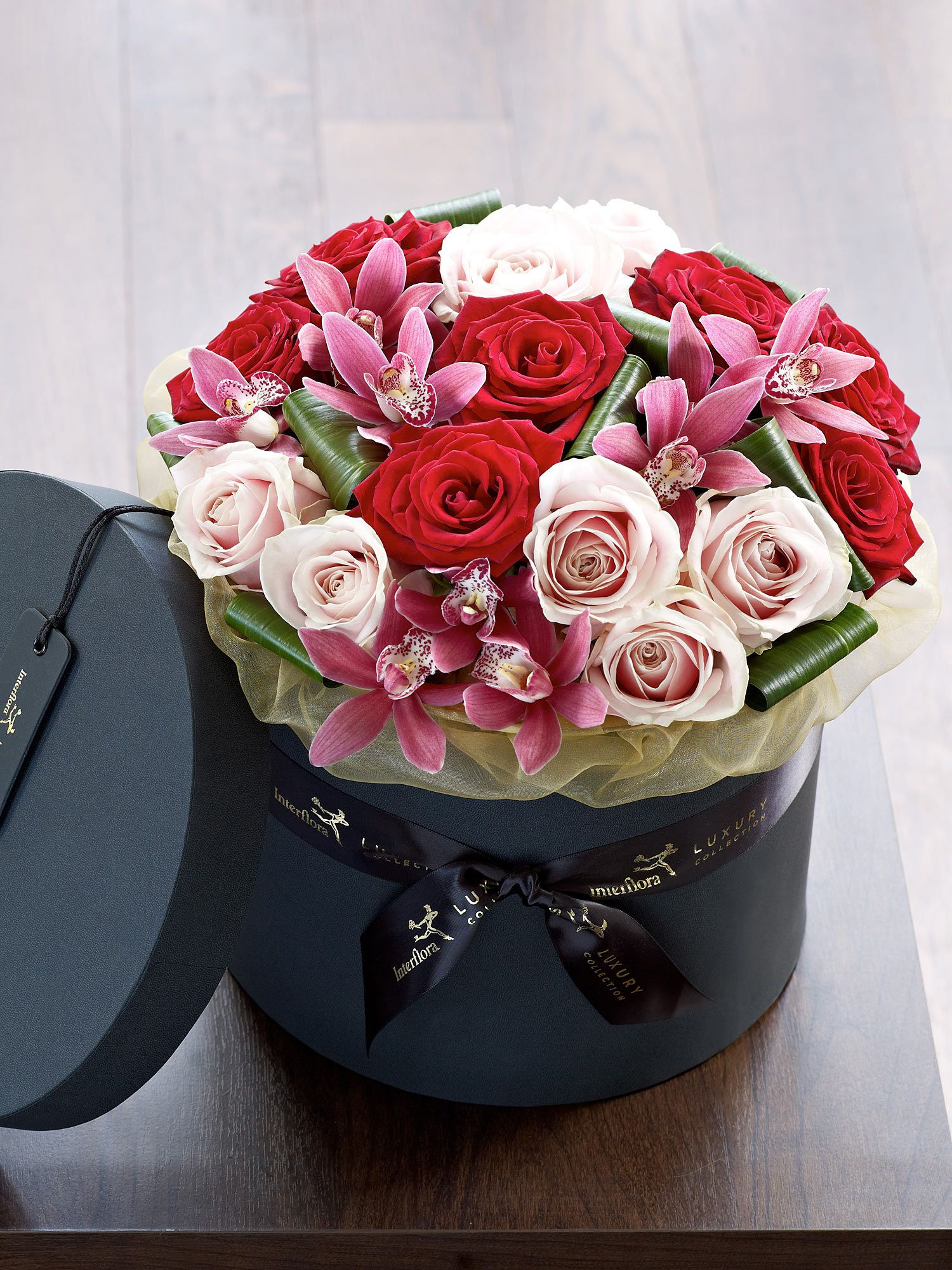 Red naomi roses and white avalanche roses in a luxurious