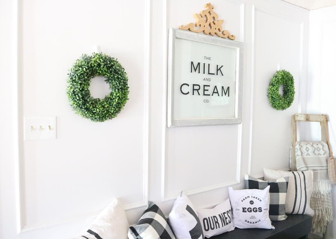 Window frame decor with wreath  picture frame molding painted wood paneling boxwood wreaths and