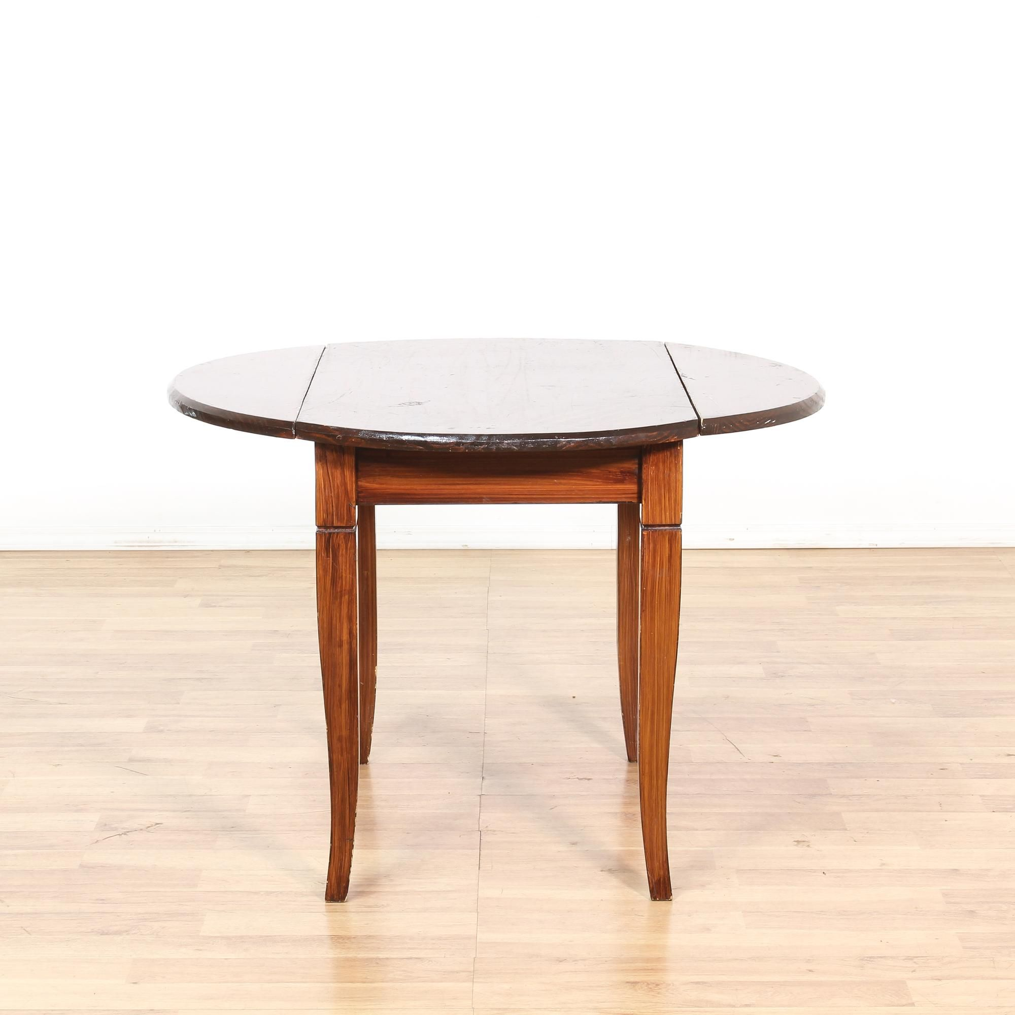 This Dining Table Is Featured In A Solid Wood With A Dark Stain. This  Traditional Style Kitchen Table Has 2 Drop Leaves, A Round Top, And Sabre  Legs.