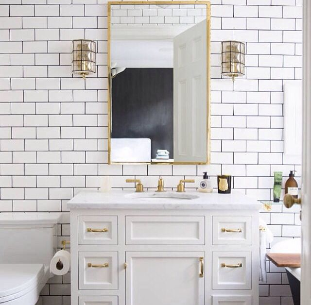 Picture Gallery For Website Bathroom white subway tile with black grout brass hardware Domino Magazine