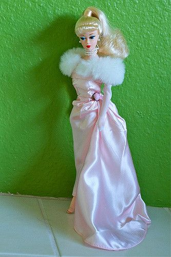 https://flic.kr/p/7Nz4Ep   Enchanted Evening Barbie   From 1995, this is a blonde version. There was also a brunette version available.  This is my very first vintage sculpt Barbie. I adore her.