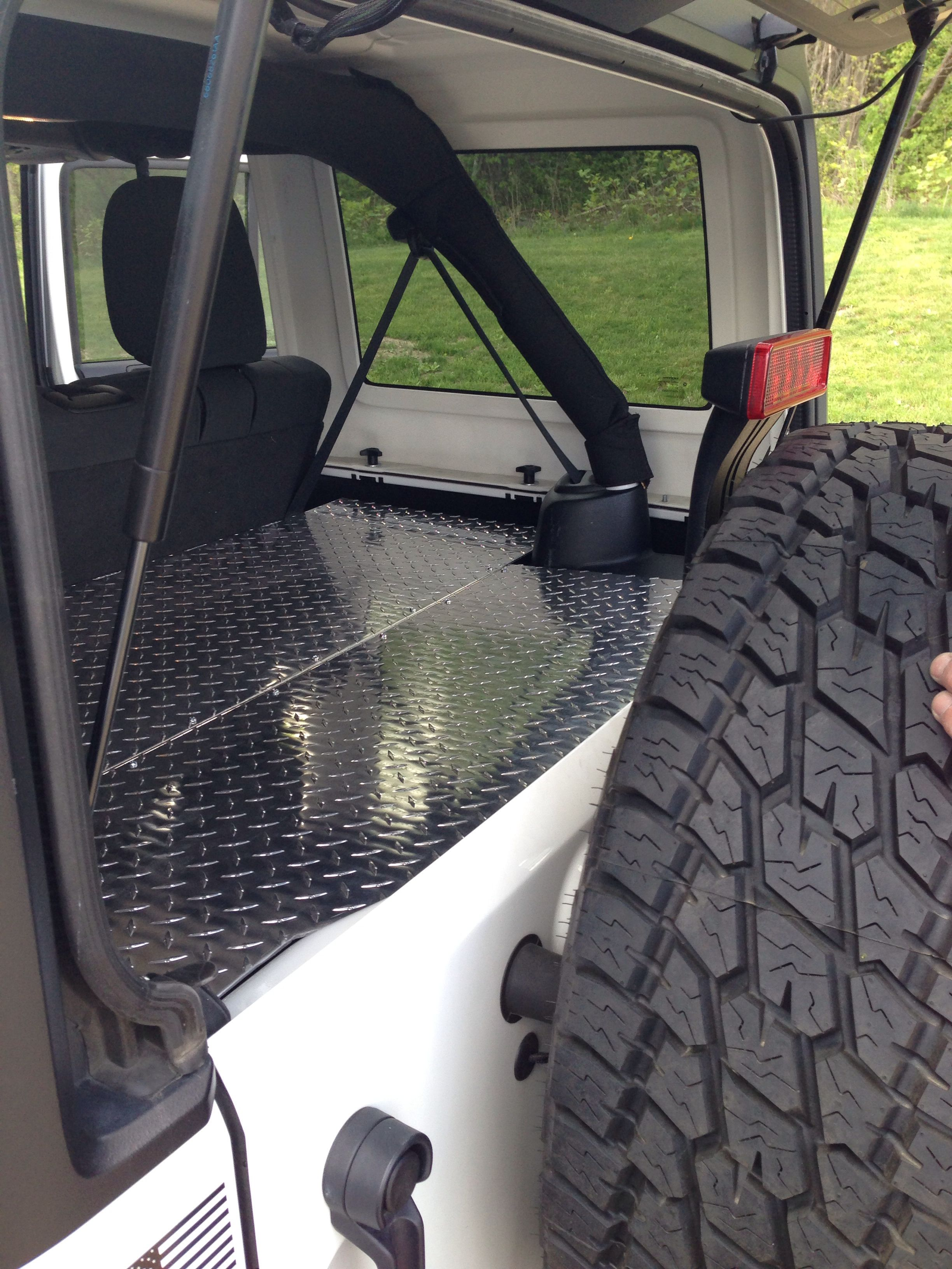 Jeep Wrangler Cargo Area Cover Made From Aluminum Diamond Plate