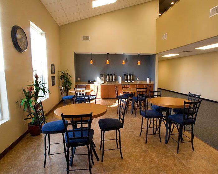 Area De Foyer : Church cafe area with tile carpet entry built in shelf