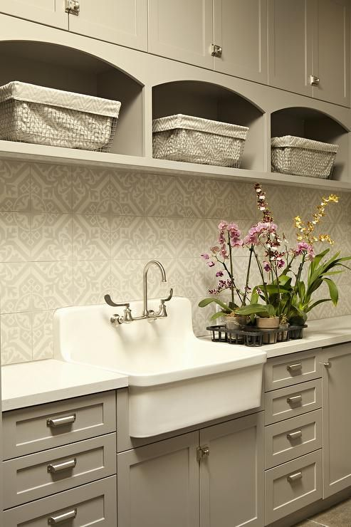 Gray Laundry Room Features Gray Shaker Cabinets Accented