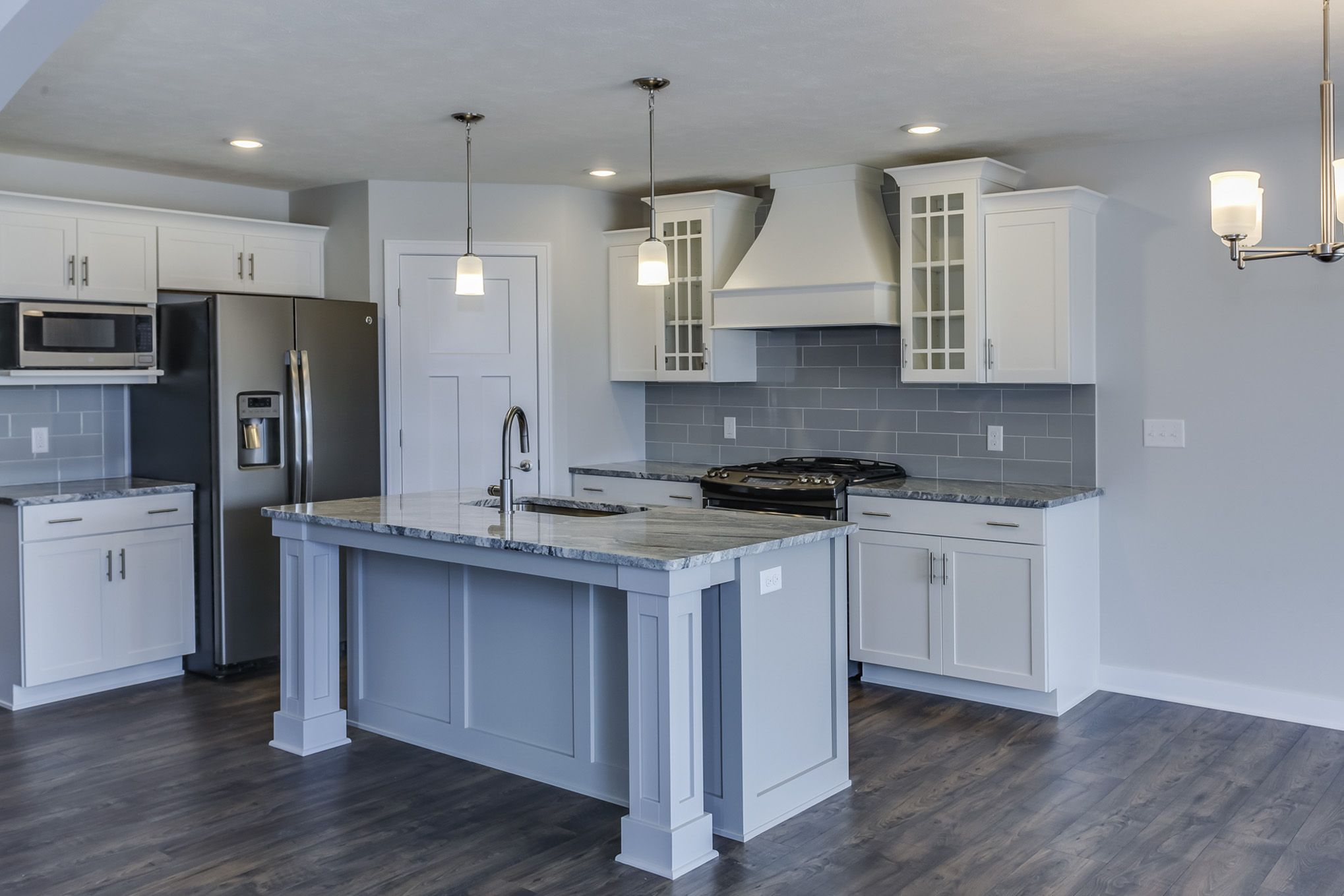 Mayfair Kitchen  Eastbrook Homes, MI #NewHome #RealEstate #WhiteCabinets  #WoodFlooring #BeautifulKitchen #EastbrookHomes