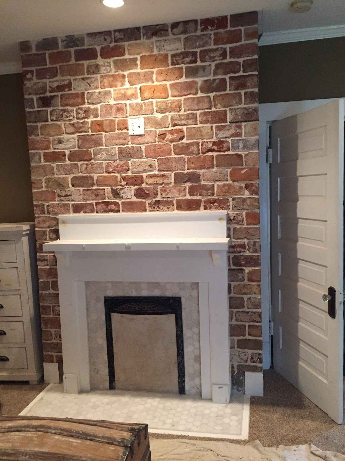 Reclaimed thin brick tiles fireplace - Tiling a brick fireplace ...