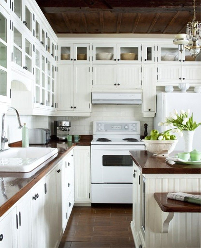 white cottage kitchen with butcher block counters