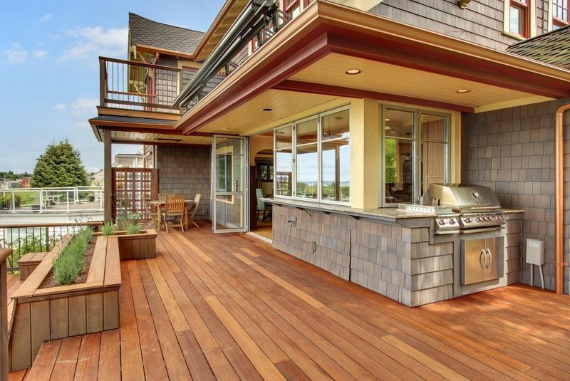 Stunning Outdoor Kitchen With Complete Operable Wall Open To Kitchen Craftsman Deck By Sortun Vo Deck Designs Backyard Outdoor Kitchen Design Built In Grill