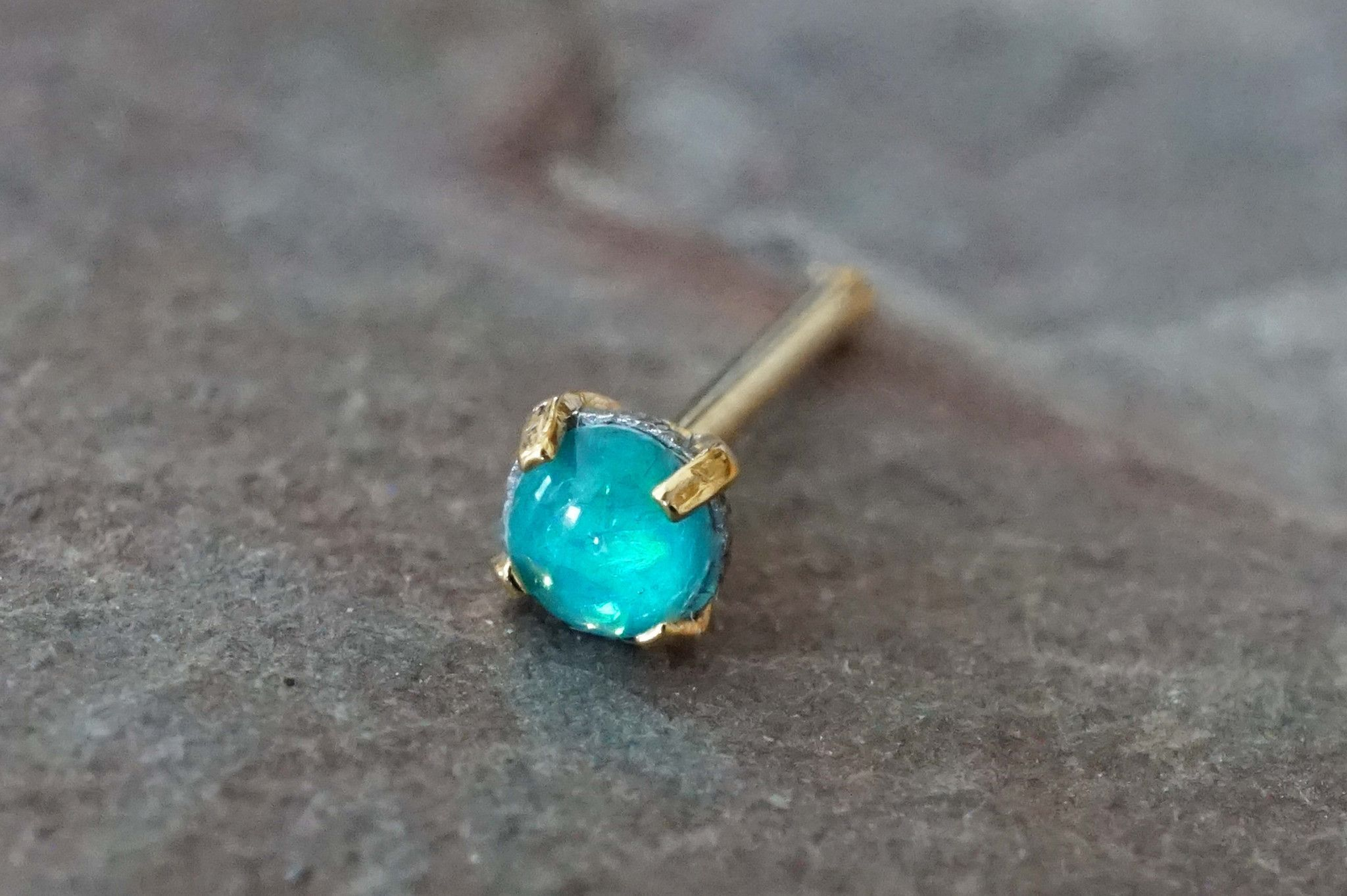 "Teal opal gold nose ring. Tiny gold nose stud with a 2mm prong set teal opal gem. 20 gauge nose ring, 1/4"" long post, made of 316L surgical steel plated gold with a tiny synthetic teal opal stone is d"