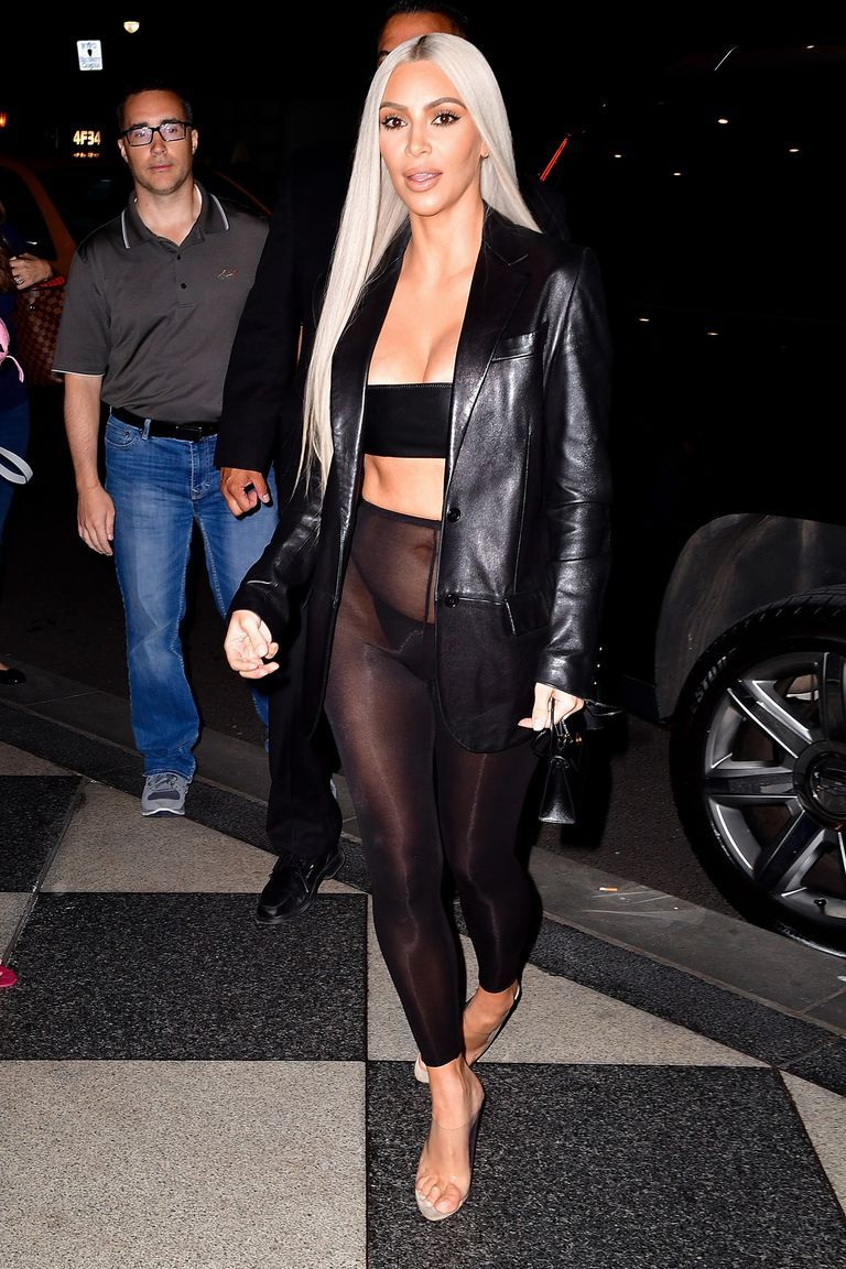 c1ed6277c3 Kim Kardashian West's Best New Looks: In a leather blazer, black bandeau,  sheer leggings, black string panties, and clear Yeezy heels while out in  New York.