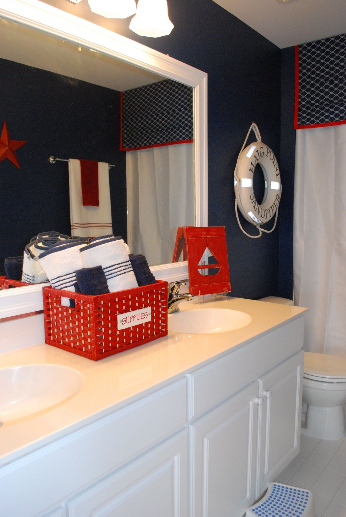 boys bathroom with a nautical theme | red accents, white cabinets