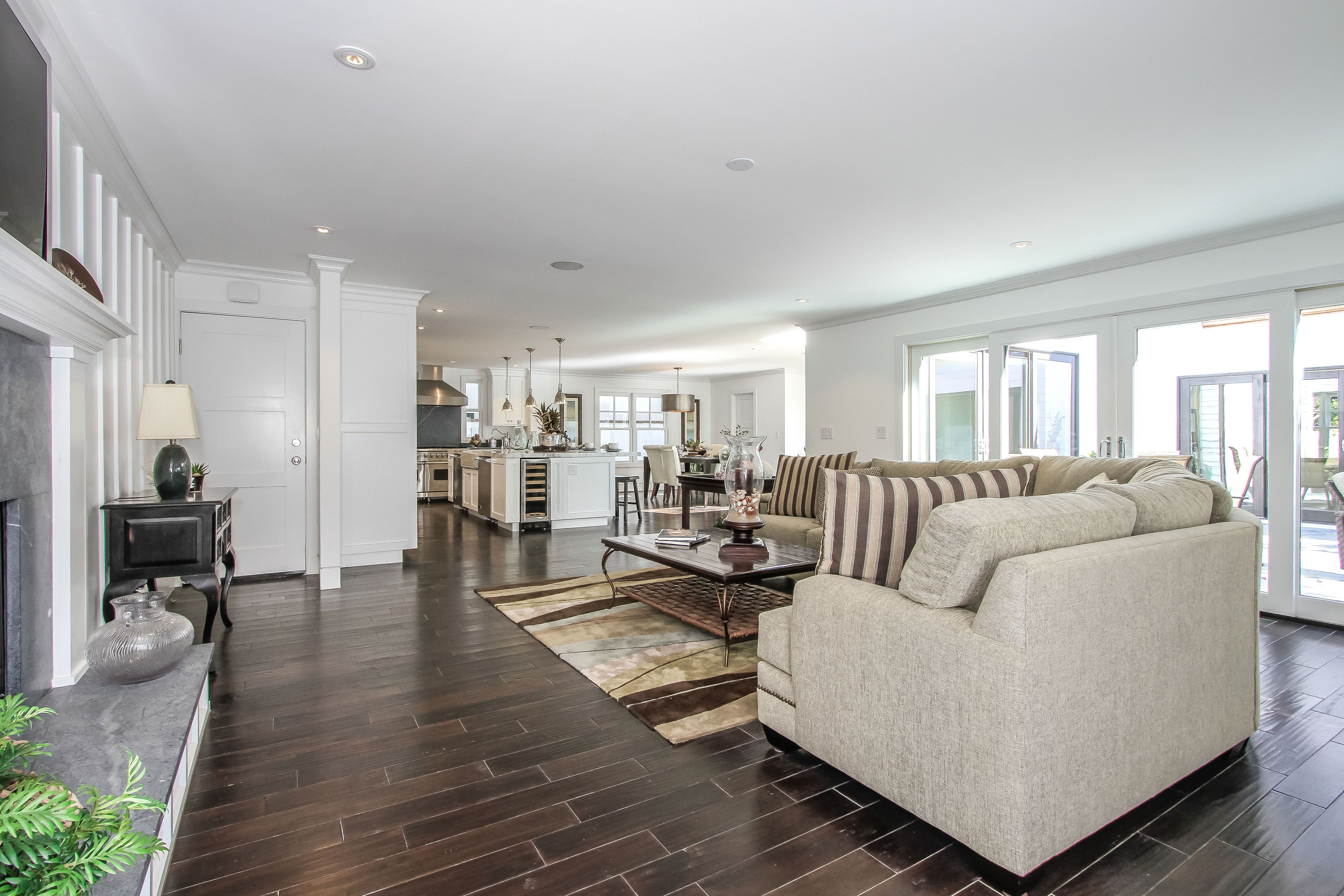 this open family room adjacent to the kitchen has hardwood
