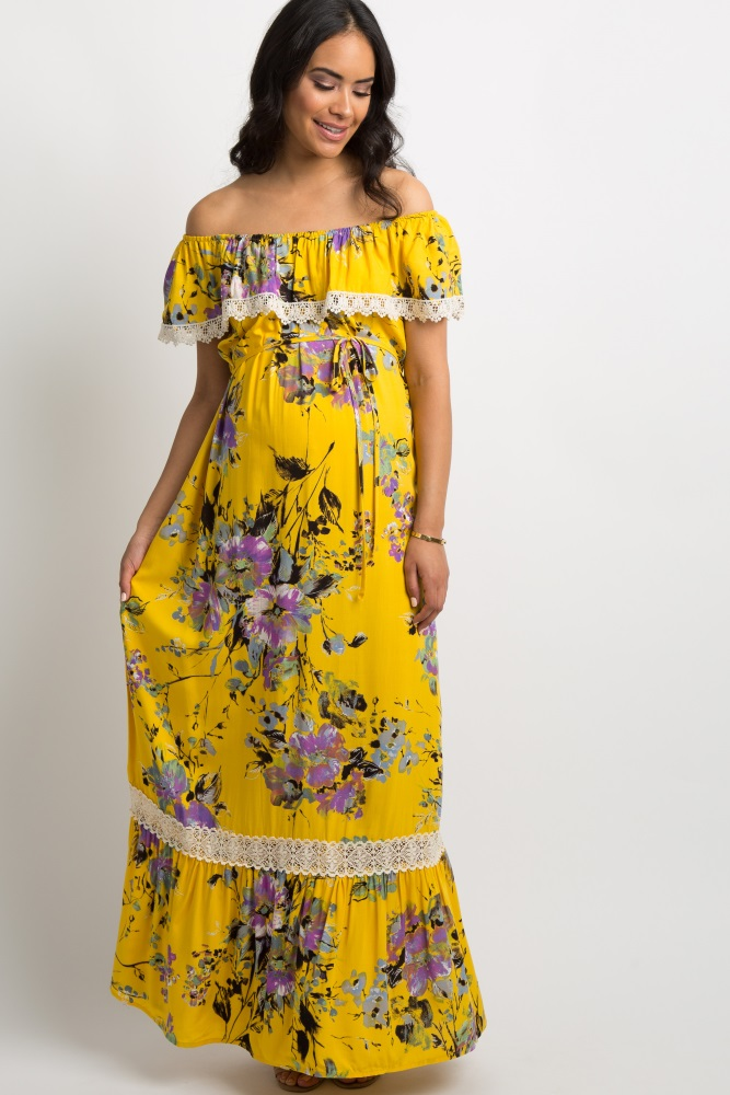 486ee885fefda An abstract floral print maternity maxi dress featuring a ruffle crochet  trim, off shoulder neckline, short sleeves, and sash tie. This style was  created to ...