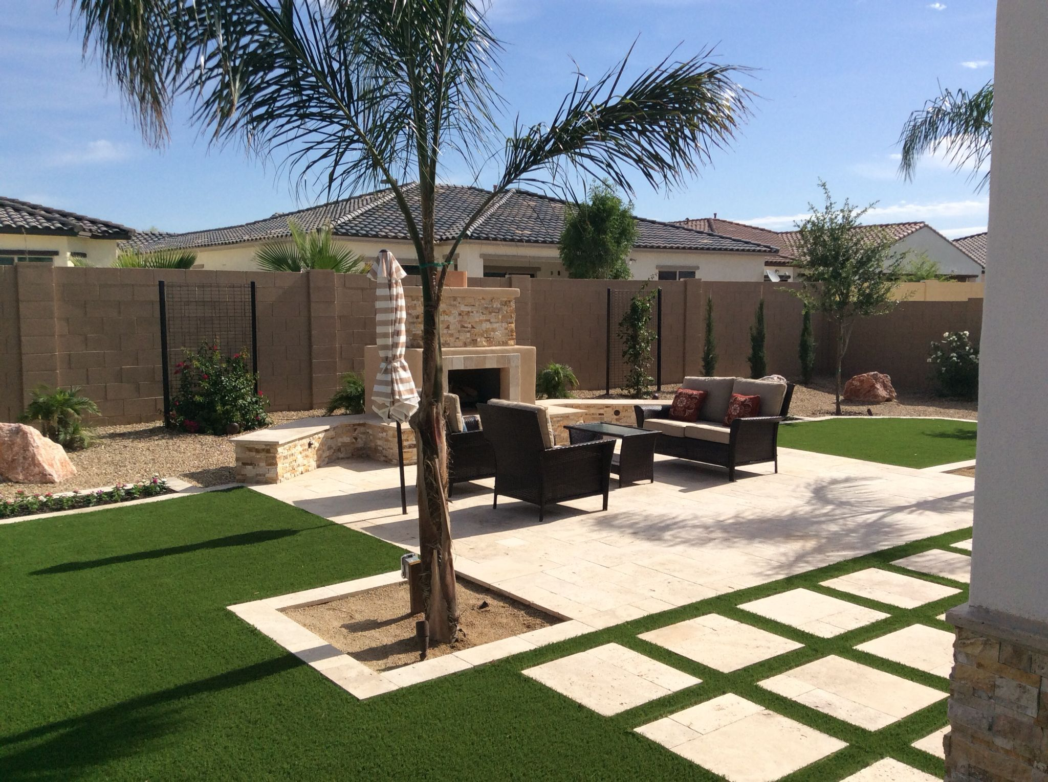 Travertine patio with Italian squares and artificial grass easy