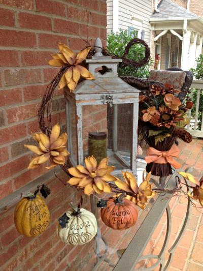 lantern a couple pumpkins make a beautiful vignette