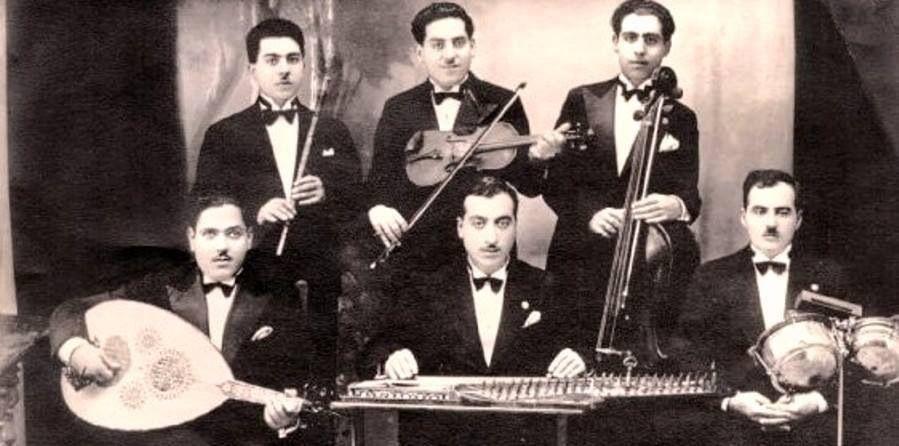 الفرقة الموسيقية الفلسطينية التي عزفت مع أم كلثوم في حيفا ويافا في زياتها الأولى ١٩٣٢ Palestine History Palestine History