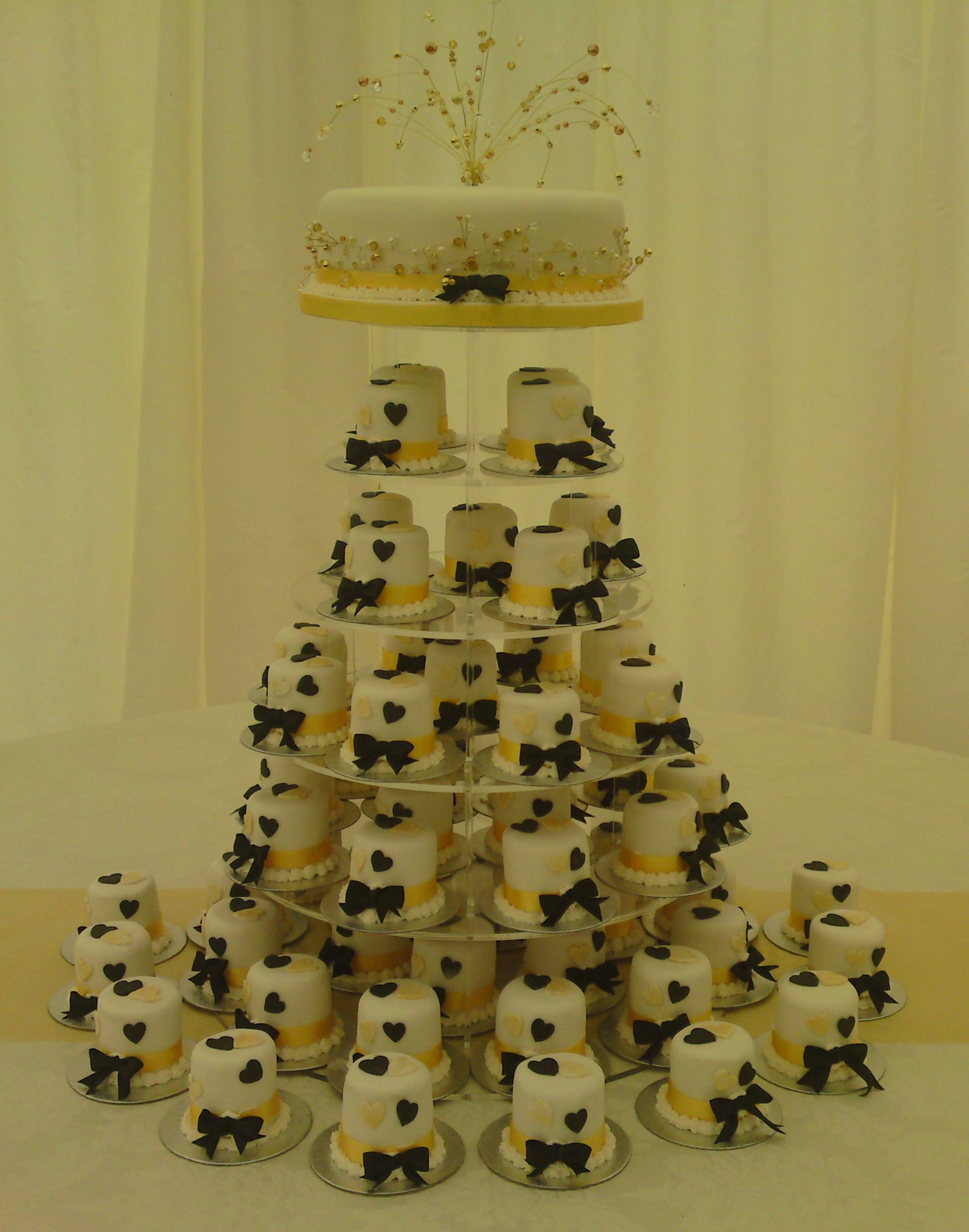 Round Mini Wedding Cakes Black And Gold Hearts Bow Tie To Each Cake