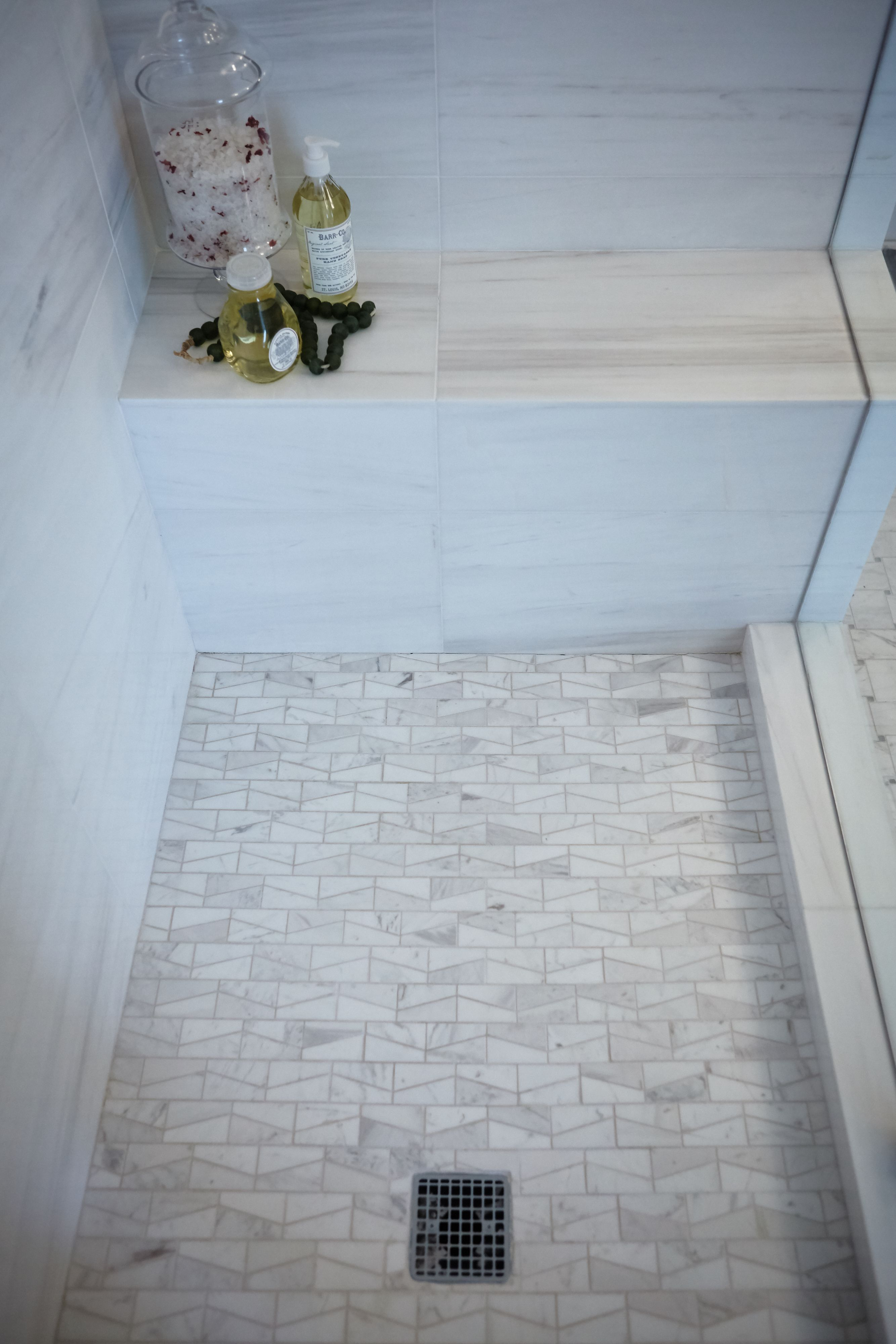 We love this all white shower with contrasting tile and patterns. It ...