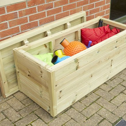 Outdoor Wooden Storage Box. This Top Opening Storage Unit Is Made From Wood  And Is
