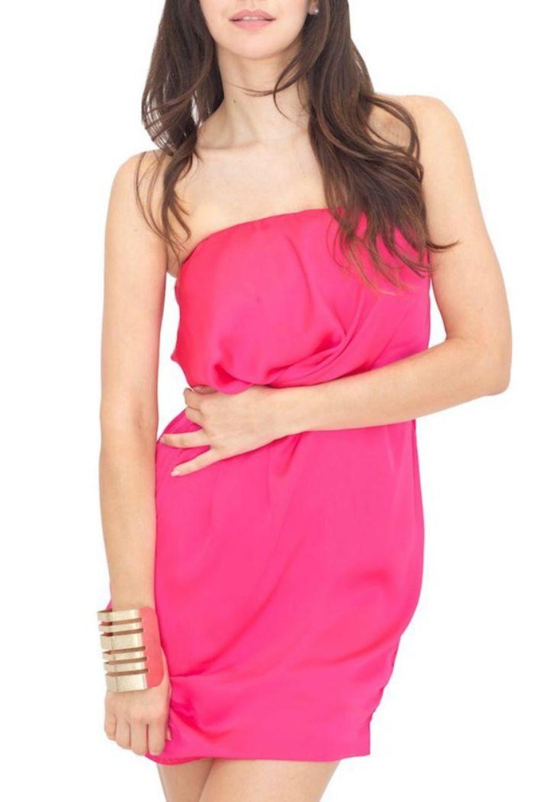 9998e6223c99 This magenta-colored dress by Vertigo features a strapless fit
