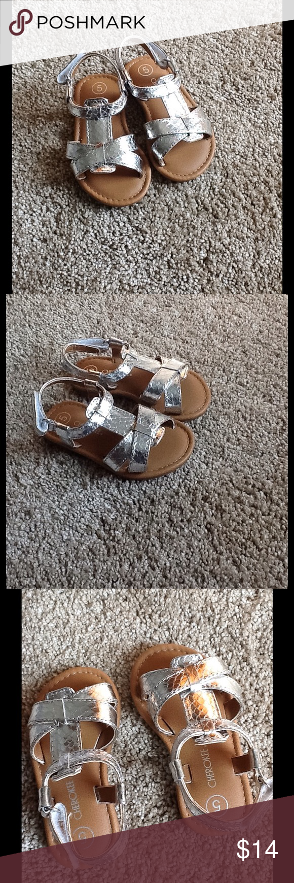 "NEW! Cherokee Girls Silver Sandals New! No longer have the tags. Never worn, my daughter just wasn't ""into"" sandals yet . Very cute! These have Velcro closure. Cherokee Shoes Sandals & Flip Flops"