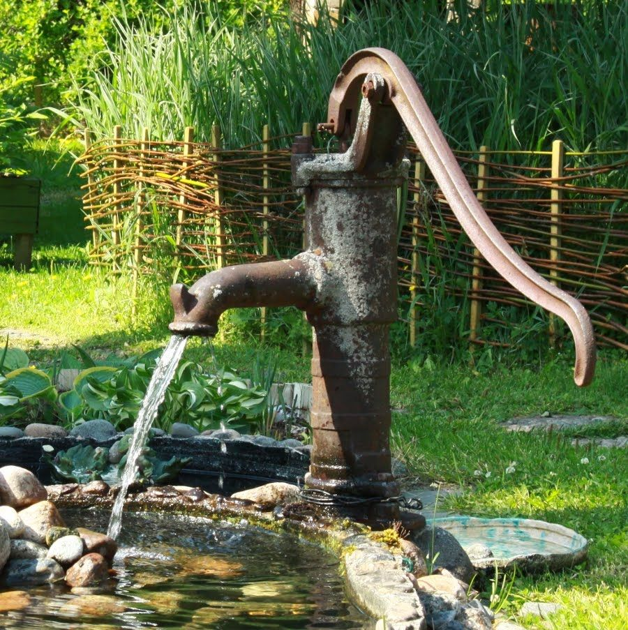 Old fashioned water pump fountains