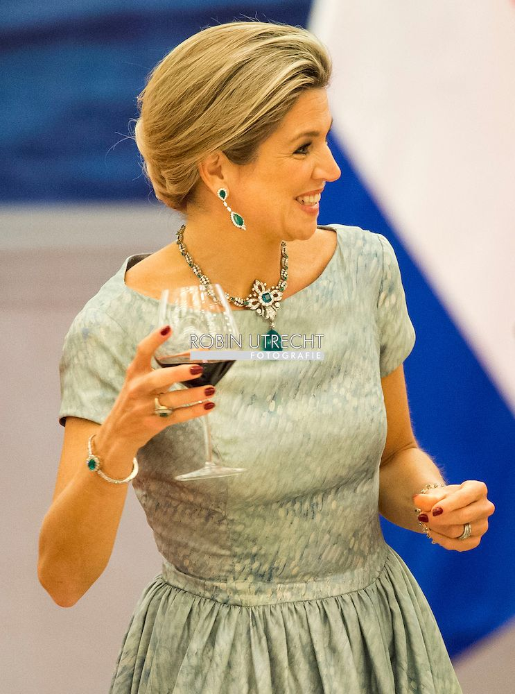 """HM Queen Maxima wearing  the necklace (with added emerald """"egg"""" pendant), bracelets and ring from the royal family's emerald parure along with her own emerald earrings, engagement ring and wedding ring. Picture taken during the state visit to China, october 2015."""