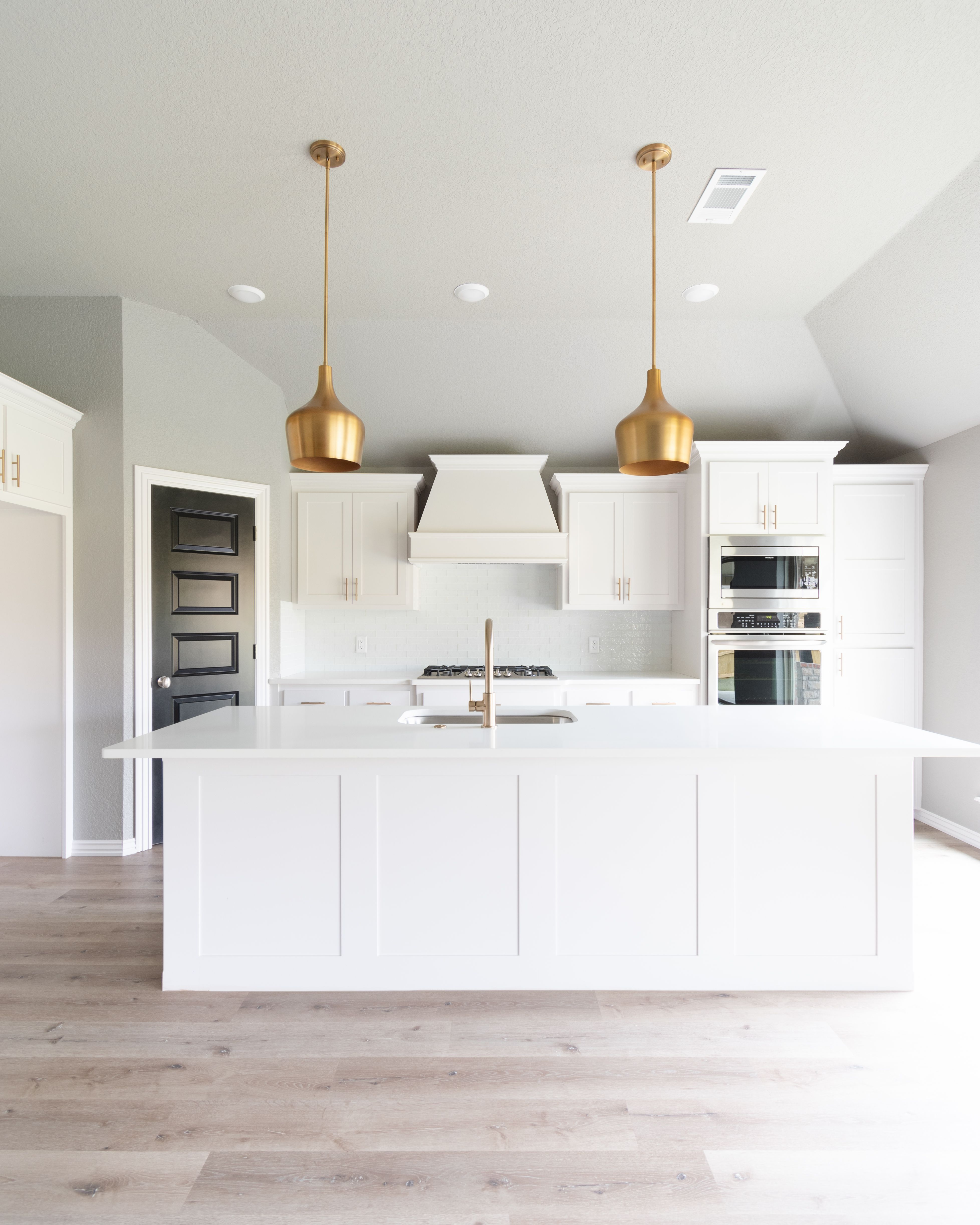 Modern White Kitchen With Modern Gold Pendant Lights White Quartz