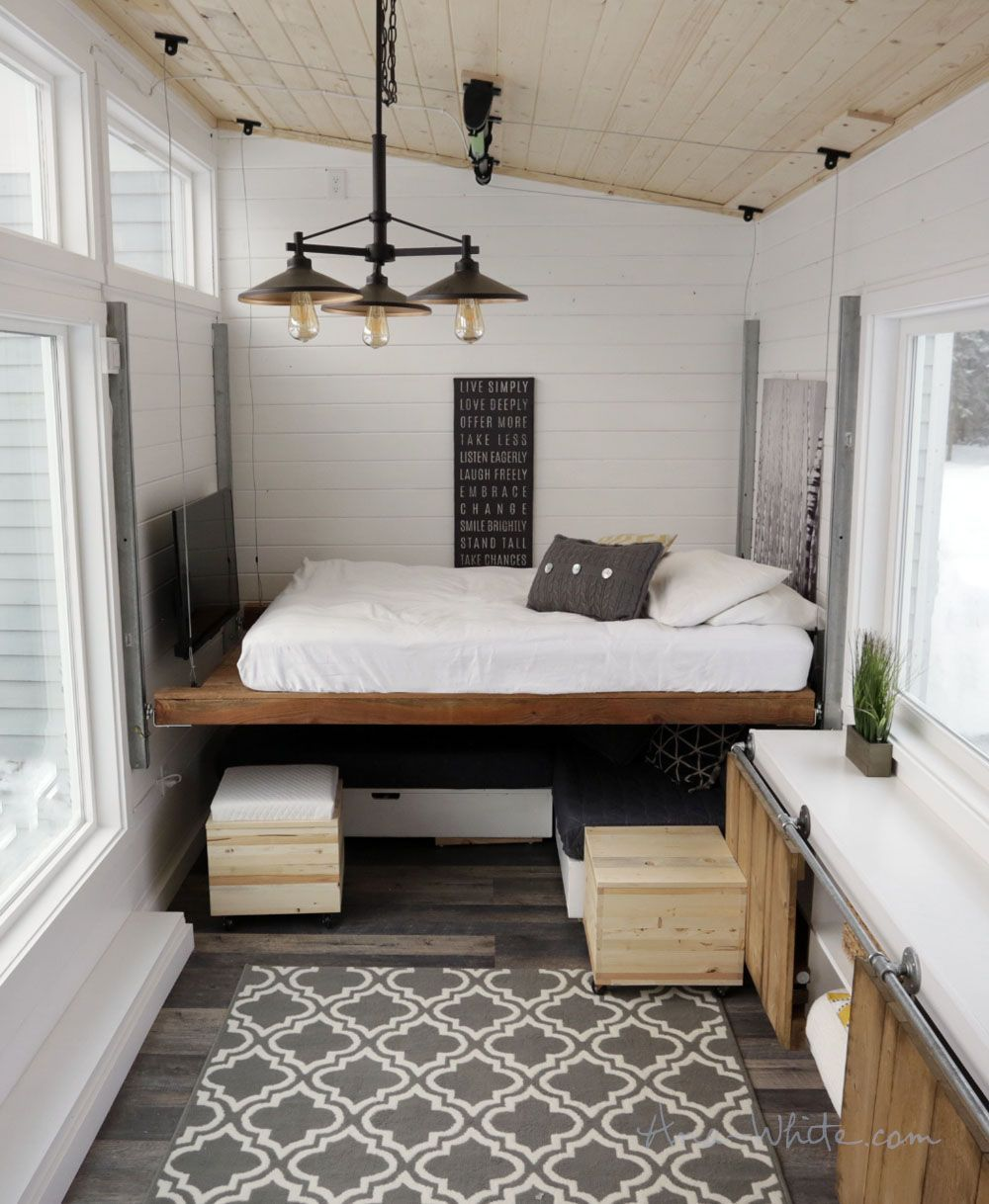 A Tiny House With A Unique Clever Bedroom Solution Tiny House Furniture Modern Tiny House Tiny House Living Room
