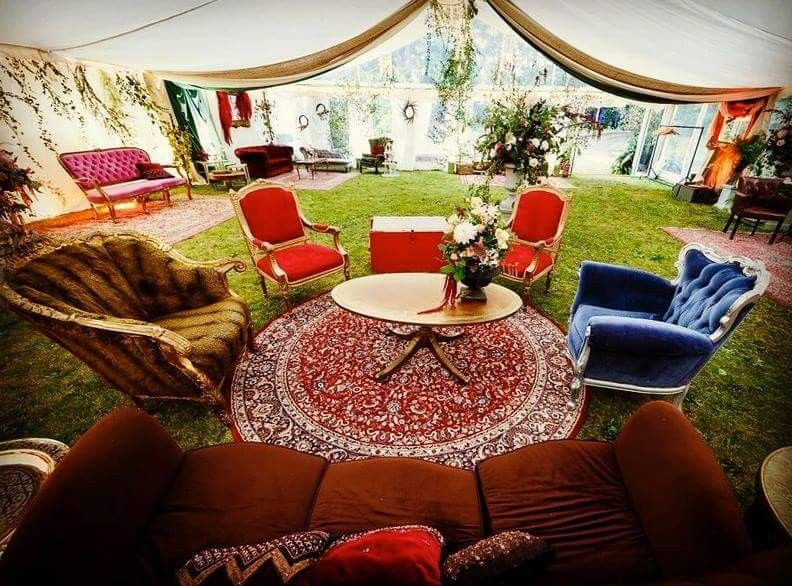 Vintage sofas and rugs in a big marquee chillout area. Hire