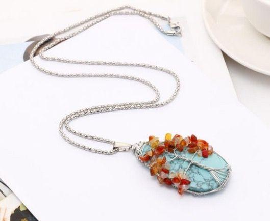 Tree of life on a turquoise gemstone pendant