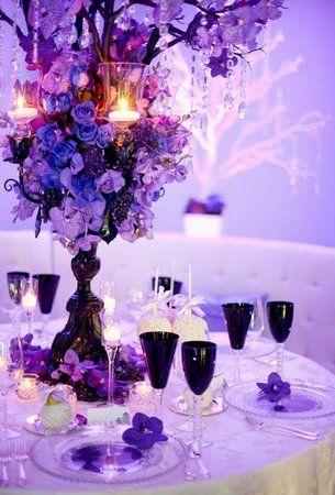 Purple Glam Centerpiece & Photo via   Black table Purple wedding and Centerpieces