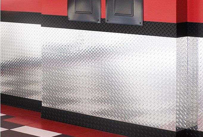 Stainless Steel For Garage Walls Is A Great Way To Protect Them From The Elements Garage Decor Plates On Wall Garage Walls