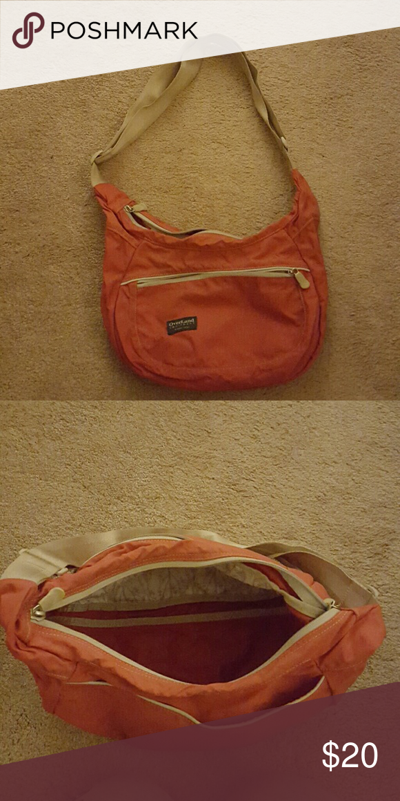 Crossbody bag Bag that can be worn over the shoulder or crossbody. Has a couple of different compartments and the bottom unzips to expand for extra room. Like brand new! Only used a couple times! Overland equipment  Bags Crossbody Bags