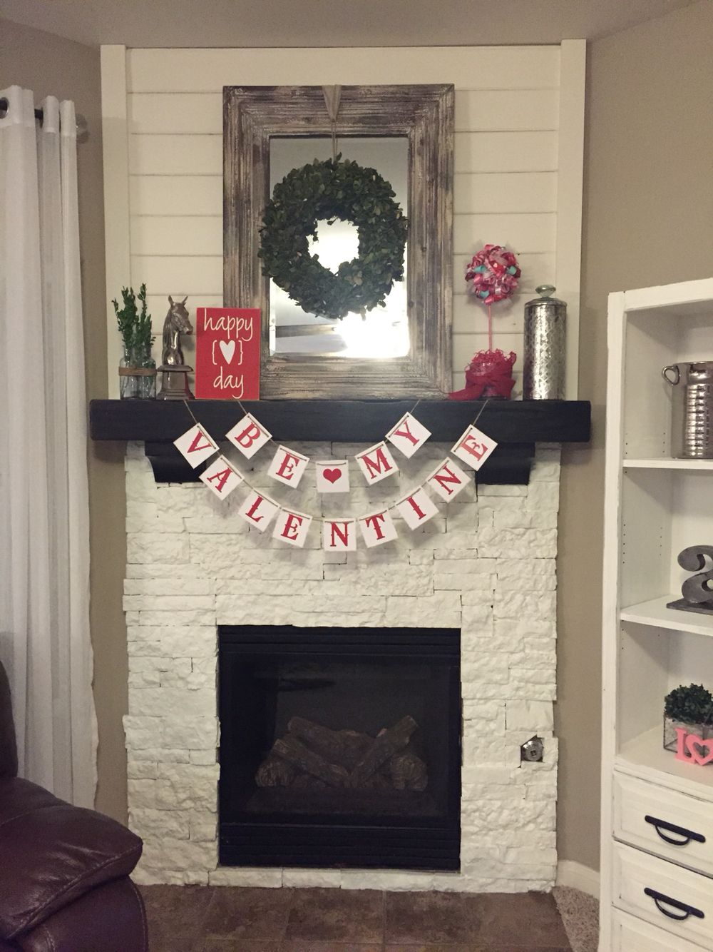white painted air stone fireplace with shiplap the tramel home