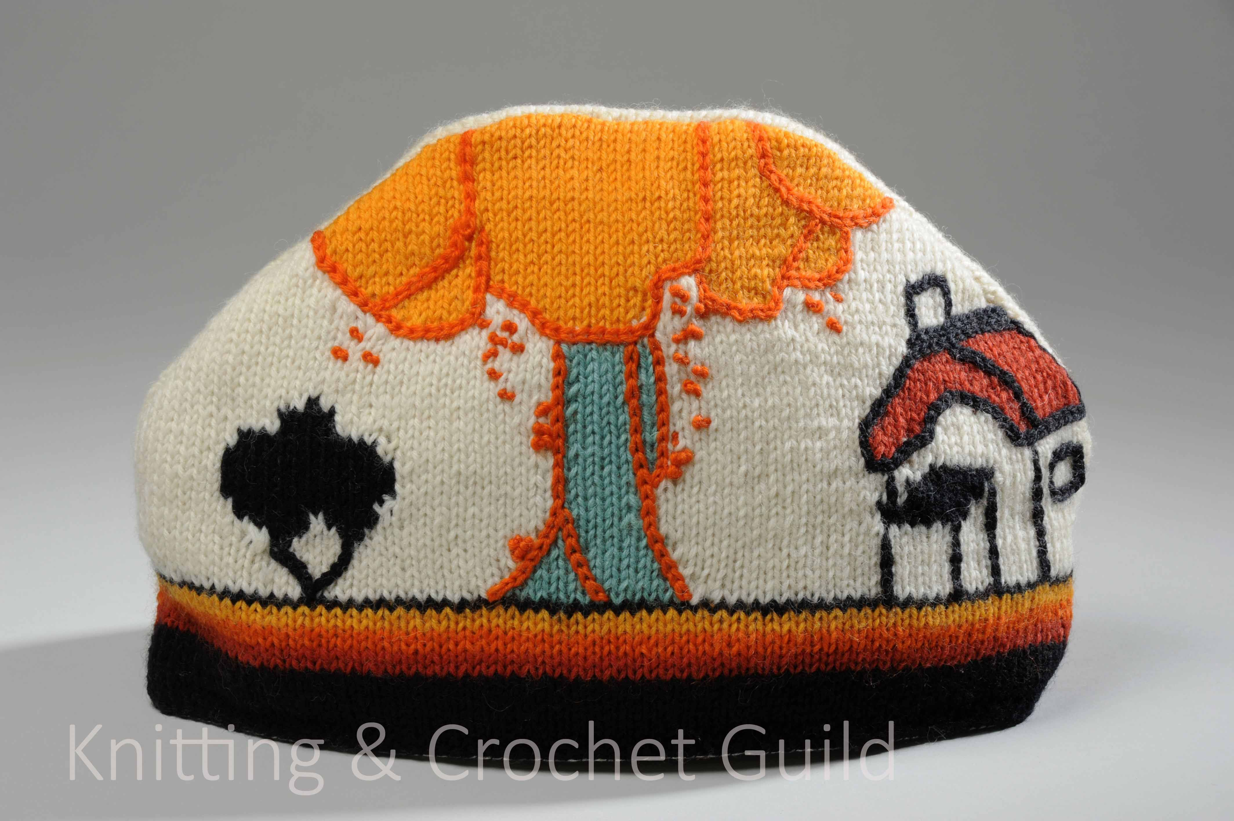 Knitted tea cosy in the style of Clarice Cliff pottery. It would match your tea set.