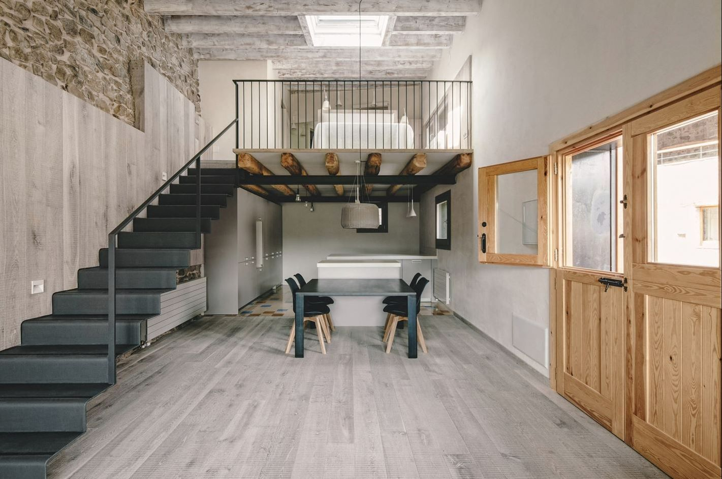 Mixing materials in a design is one of my favorite things to do! This fabulous space by Dom Arquitectura in Spain flawlessly mixing a variety of materials to create this amazing space! The natural feel of the wood and stone plays so elegantly with the iron staircase!