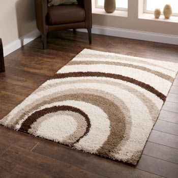 This luxurious thick rug features a contemporary design in a crisp ivory colour palette.    The wave effect pattern in ivory, beige and brown is fantastic for adding warmth and comfort to a room space.    The Majesty collection includes a modern selection of eye catching rugs featuring both patterned and plain designs.