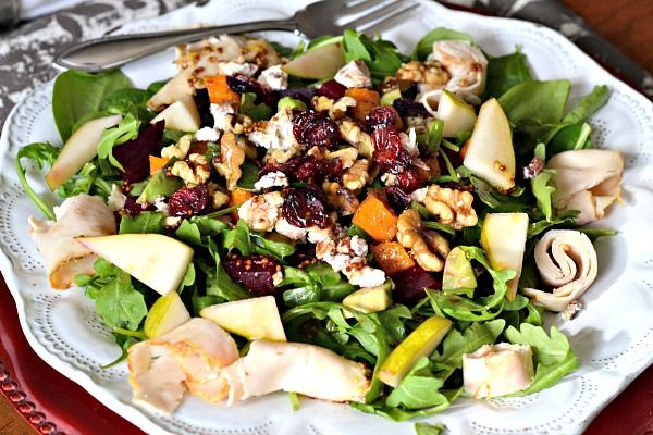 Spinach, arugula, pears, roasted butternut squash, beets, avocado, toasted walnuts, cranberry pecan goat cheese, deli chicken, dried cranberries and a maple dijon balsamic vinaigrette.