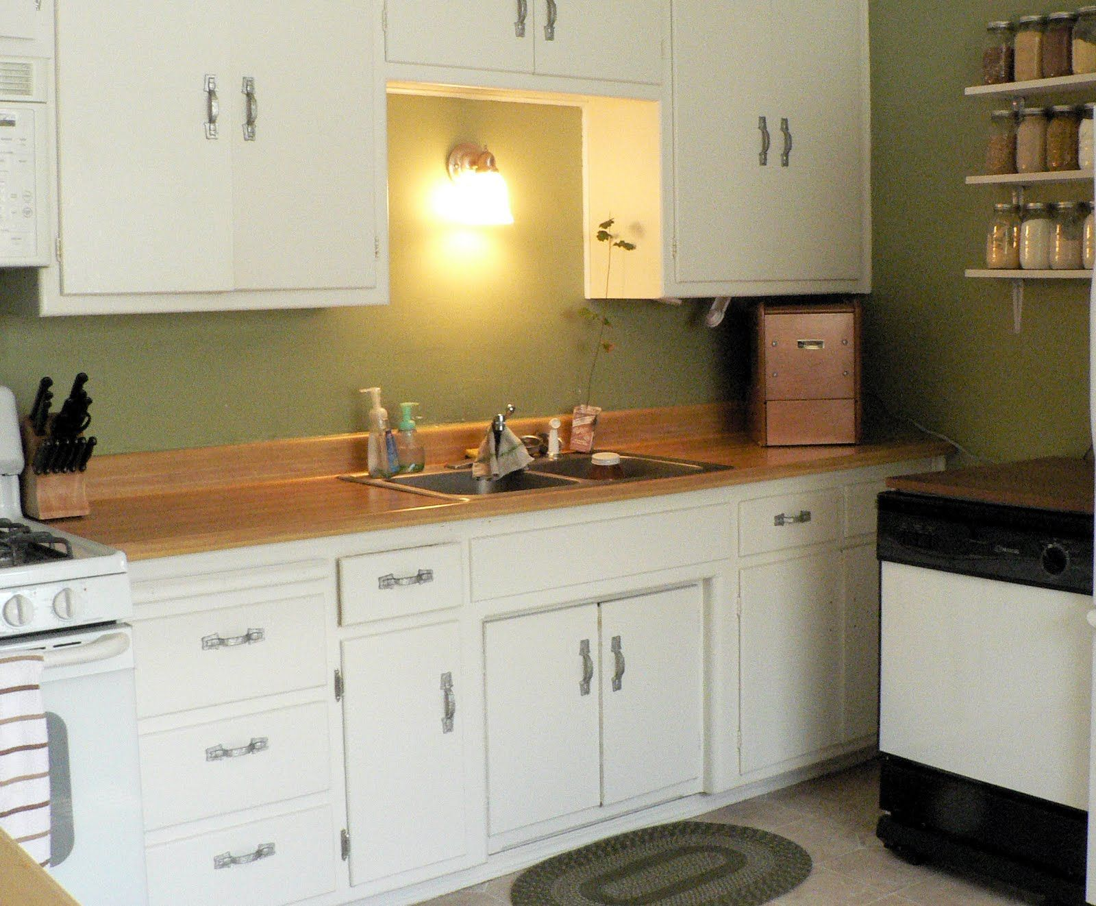Inspiring sage green kitchen cabinets with wooden countertops also