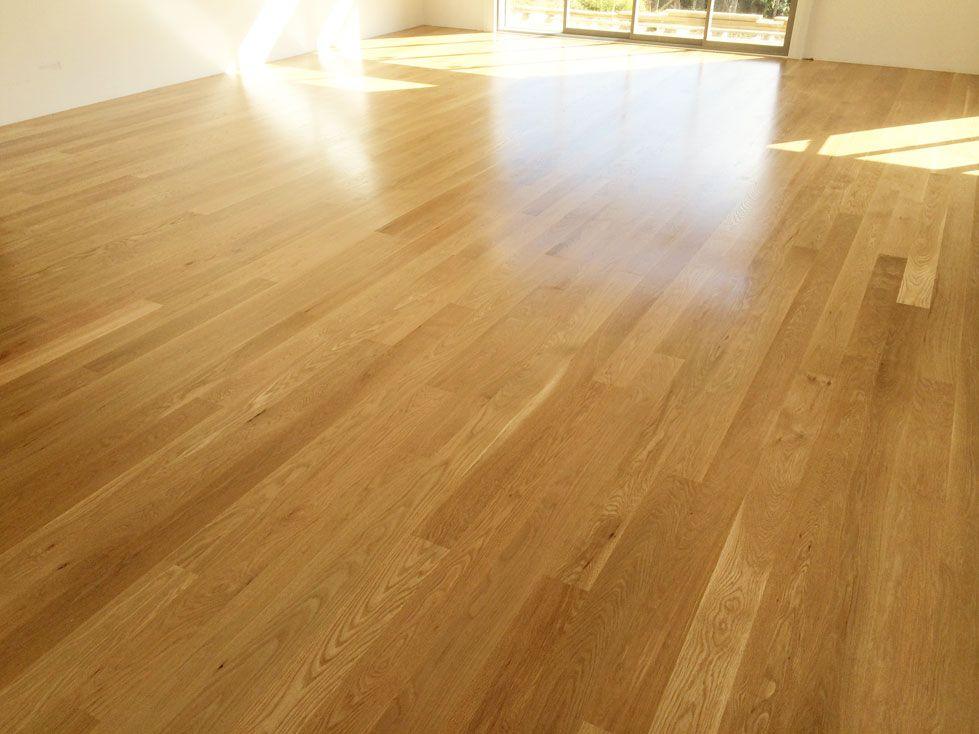 American White Oak Flooring With A Satin Water Based Polyurethane Finish.