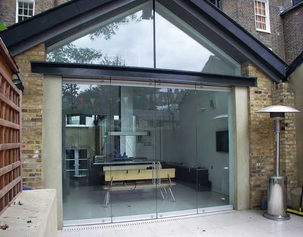 fantastic solid glass doors and room dividers inviting natural light into modern interior design - Modern Glass Exterior Doors