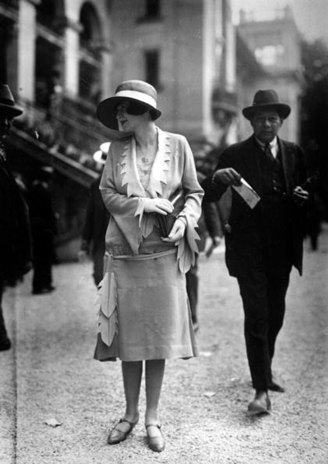 1921:  A woman models models the latest fashion of the day in a Paris street by Seeberger Freres on Getty Images.