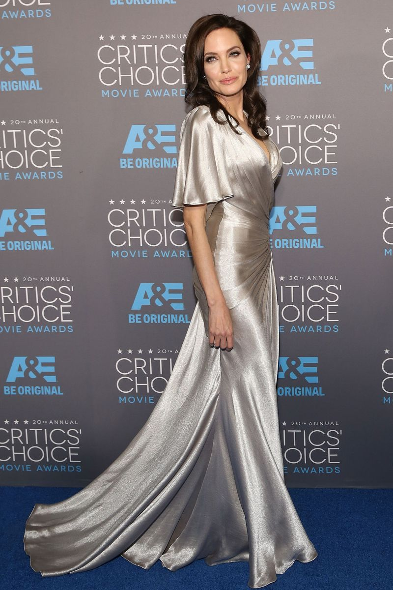 49439a263932 Angelina Jolie in a metallic silver silk gown by Atelier Versace at the  20th Annual Critics  Choice Movie Awards (January 15