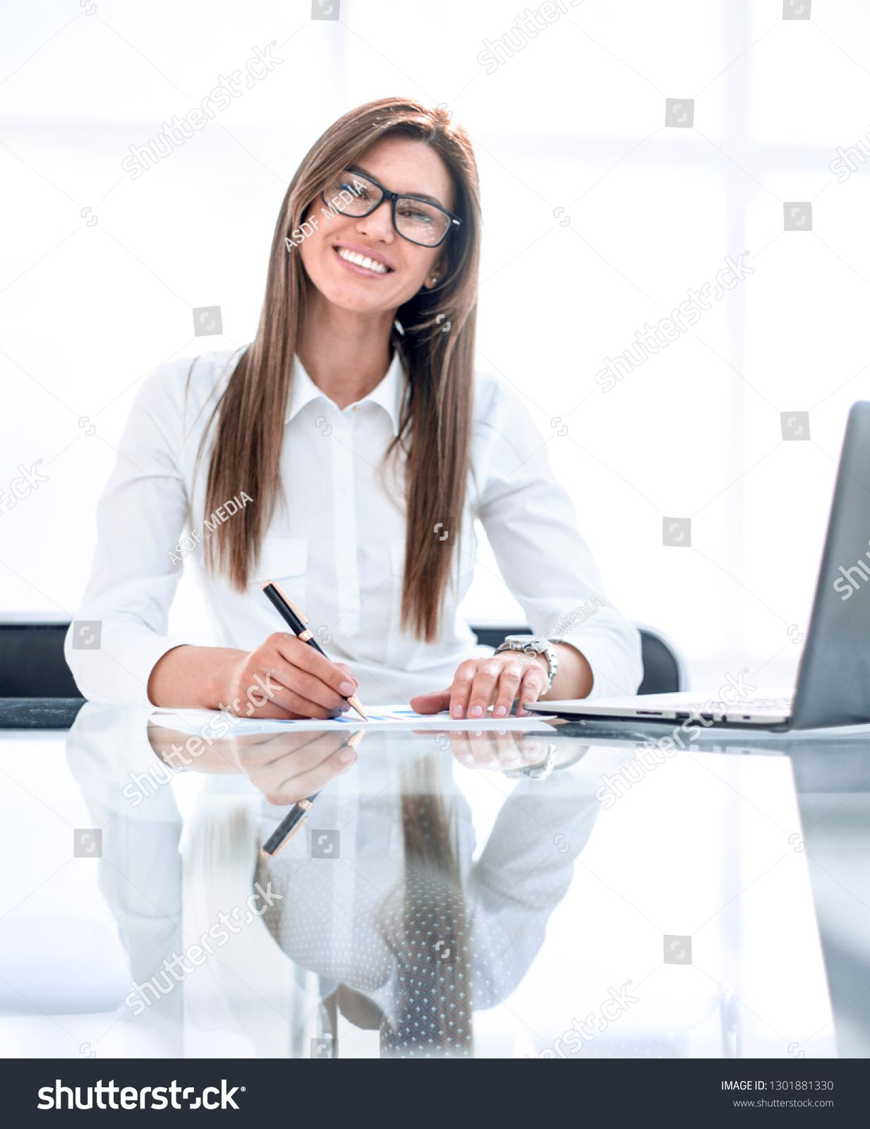 Successful Business Woman Sitting At The Office Desk Sponsored