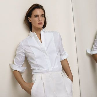 Modern wears Autograph white shirt and tailored trousers